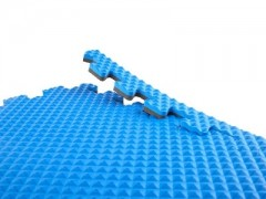 close up photo of a blue Nork flooring mat