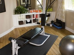 Photo of a home gym with hardwood floors and equipment on top of Norsk PVC flooring