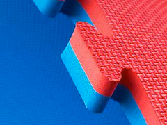 detail photo of red and blue Norsk flooring